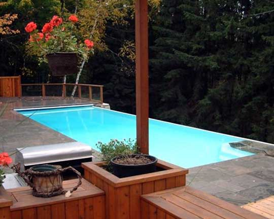 Dream swimming pools fiberglass vinyl liner pool kits for Fiberglass above ground pool
